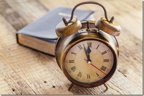 clock-bible-wood-concept-showing-few-minutes-to-twelve-o-focus-41026617